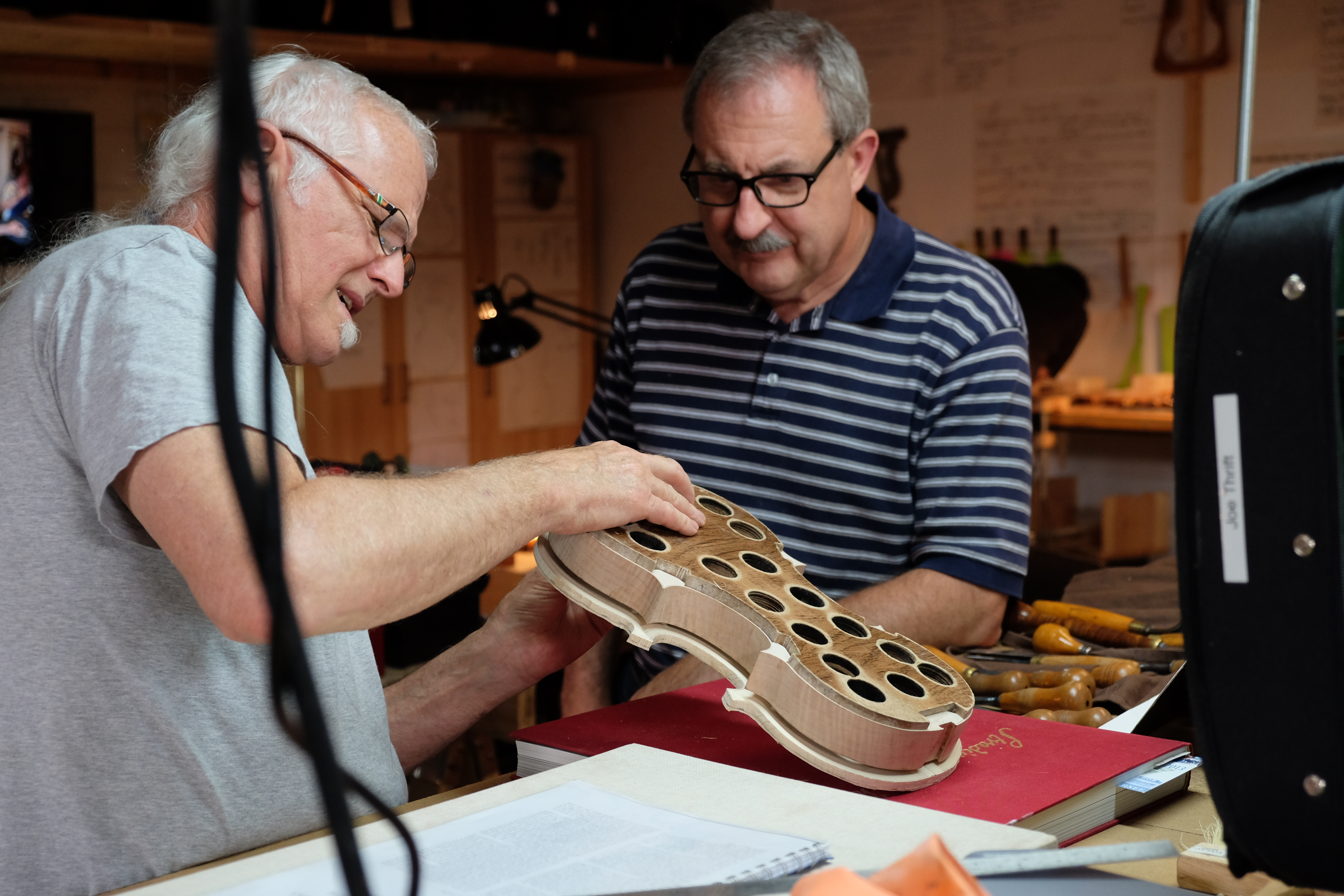 Violin makers converge for two weeks at local shop