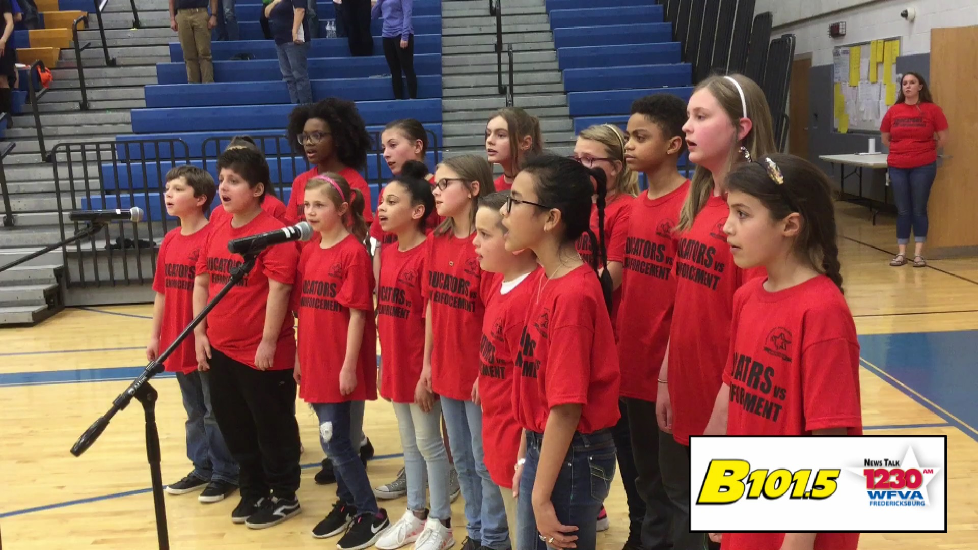 Stafford DARE students open annual basketball game with National Anthem